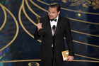 Leonardo DiCaprio accepts the award for best actor in a leading role for 'The Revenant' at the Oscars. Photo / AP