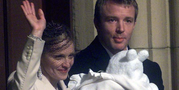 Pop star Madonna waves to the crowd as Guy Ritchie holds their son Rocco after his baptism at Dornoch Cathedral in 2000. Photo / AP