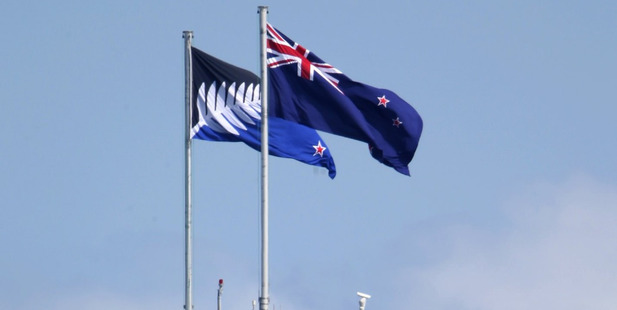 The Kyle Lockwood-designed silver fern flag flies on the Auckland Harbour Bridge next to New Zealand's current flag. Photo / Greg Bowker