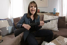 TV3 journalist and Story presenter Heather du Plessis-Allan displays a .22 calibre sporting rifle that she purchased via the internet using fake documentation. Photo / TV3
