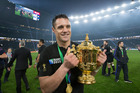 Dan Carter with the Webb Ellis Cup after at Twickenham Stadium. Photo / Brett Phibbs