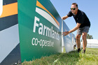 SMC Events manager Dave Mee adjusts Farmlands advertising in the main ring.