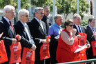Male MPs, unionists and other supporters demonstrated men's support for fixing the gender pay gap carrying Equal Pay day red bags. Photo / NZPA