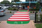 An artist's impression of the new red and white striped crossings.