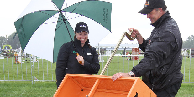 DOODY DUTY: Jeff Young, right, shows his SuperScooper to Jenny Tukiwaho Stokes, of Hamilton, at the Hawke's Bay Showgrounds yesterday. PHOTO/Duncan Brown