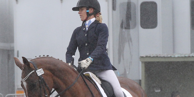 SODDEN START: The opening day of competition at HoY was hampered by wet weather. Pictured is Irina Smith, of Cambridge, on Affaire D'Amour, competing in the dressage. PHOTO/Duncan Brown