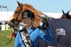 Katie Laurie and Dunstan Springfield celebrate the Lady Rider of the Year spoils at the Hawke's Bay Showgrounds, Hastings, today. PHOTO/Duncan Brown