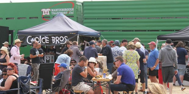 A wall of trucks protects Martinborough Brewday stallholders and punters. PHOTO/ANDREW BONALLACK