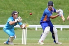 Bay of Plenty Indian Sports player Yohann Irani (right) and Central player Johnny Barrow in action during the local derby. Photo / Ben Fraser