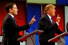 Republican presidential candidates Marco Rubio and Donald Trump argue during a primary debate in Detroit. Picture / AP