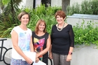 Petra Lagas (left) and Jan Millar receive their prize packs from Hastings district councillor Cynthia Bowers.