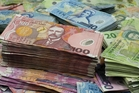 The New Zealand dollar got dragged down after local figures showed building consents dropped in January.