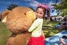 Briearn Egan, 4, hugs her teddy at the teddy bears' picnic. Photo / Ben Fraser