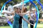 Despite the heat, troupe leader Lisa Le Fae, Maree Patton, Jewel Gray and Jan Hartshorn from Bellishus Performance Troupe rehearse their fan veil routine in the Marine Parade Gardens, in preparation for the MEDANZ Festival in Wellington. Photo / Duncan Brown