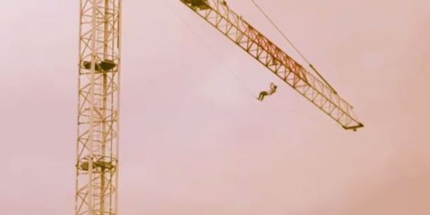 The man has no recollection of how he got to the top of the crane. Photo / futuredaz Instagram
