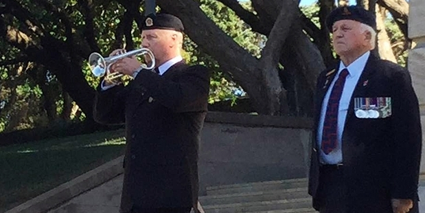 Frank Lundberg (left) playing the Last Post at the Pukeahu National War Memorial in Wellington.