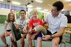 William Pike shows his artificial leg to Year 8 Havelock North Intermediate students Rosemary Yorke (left), Nicholas Waitoa and Connor Grant. Photo / Warren Buckland