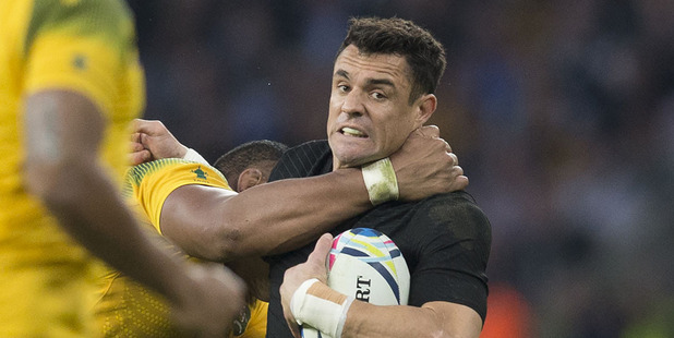 Dan Carter is tackled during the Rugby World Cup final. Photo / Brett Phibbs