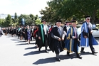 The graduates from University of Auckland's Tai Tokerau campus march through Whangarei to Forum North where they officially graduated on Friday. Photo / Michael Cunningham