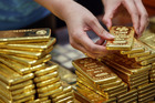 The IRD has released a draft document saying people should pay tax on profits from buying and selling gold. Photo / Bloomberg