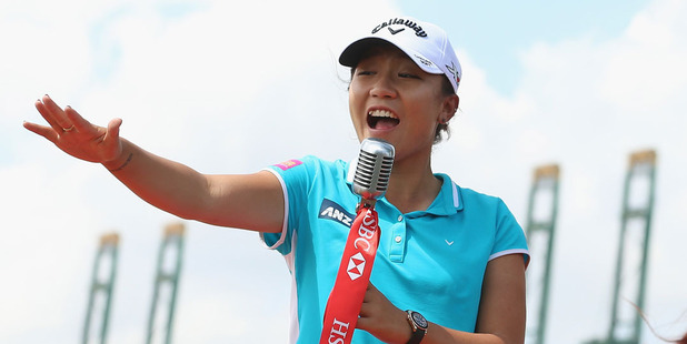 Lydia Ko sings on stage during a photo call ahead of the latest LPGA event. Photo / Getty