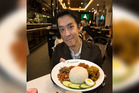 Steven Loh with some of the PappaRich chain's signature dishes. Photo / Doug Sherring