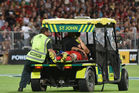 The injured Reed Prinsep of the Crusaders is brought off the pitch after suffering a concussion. Photo / Getty