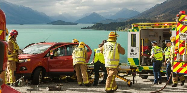 The woman was taken to hospital with minor injuries to her lower legs. Photo / James Allan