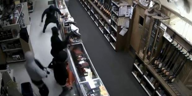 The hooded thieves smashed a row of glass cases with hammers and seized handguns. Photo / Crime Stop Houston