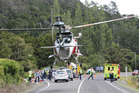 The Northland Electricity rescue helicopter lands on SH10 near Kaeo after a two vehicle crash today. Photo / Peter de Graaf, Northern Advocate