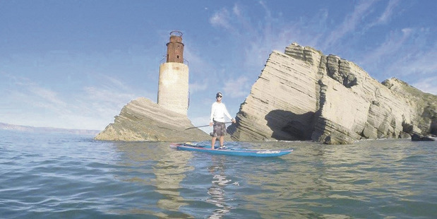 Peter Ralph, 25, started the journey on his 17-foot stand-up paddleboard 25 days ago. Photo / Gisborne Herald