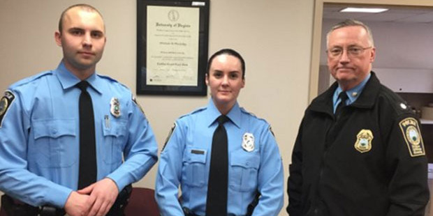 Officer Ashley Guindon, centre, is welcomed to the force the day before she was killed in the line of duty. Photo / Prince William County Sheriff's Department / AP