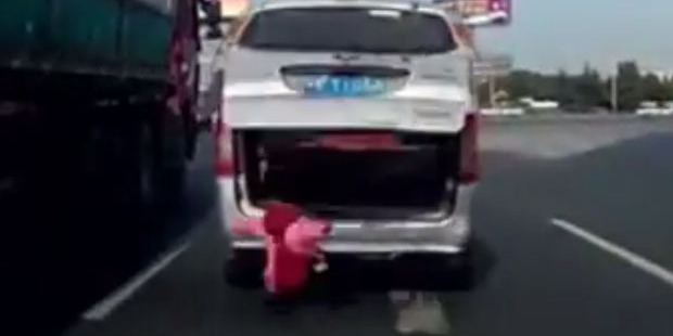 The toddler fell from the boot of the vehicle as his grandfather was driving.