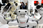 A Nachi-Fujikoshi Corp. industrial robot operates during a demonstration at the International Robot Exhibition 2015 in Tokyo. Photo / Bloomberg