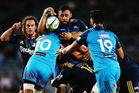 Patrick Tuipulotu of the Blues looks to offload against the Highlanders. Photo / Getty