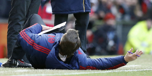 Manchester United manager Louis van Gaal, on the ground as he complains to the officials. Photo / AP