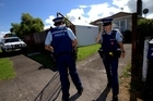 Police leave the property of 9 Wayne drive in Mangere where a police search is currently under way. 06 March 2016. New Zealand Herald photograph by Nick Reed