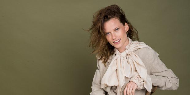 Mahsa raw silk blouse $550. Twenty-seven Names linen blazer $390 and mid-length skirt $280. Karen Walker earrings $949. Mimco heels $229. Citta Design bistro chair $249. Photo / Greg Bowker