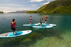 Stand-up paddleboard (SUP) lessons and yoga classes are available at registration for the three-day event in Rotorua.