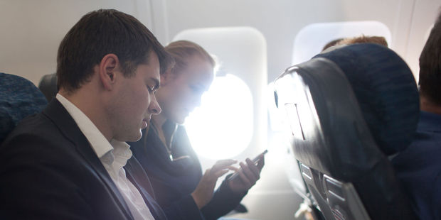 There are more ways than ever for air passengers to annoying each other. Photo / 123RF