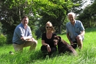 Simon Upperton (left), Robyn Terlesk (with chocolate lab Ruger) and John Horrell are part of a group hoping to buy a block of undeveloped land on Kerikeri's Inlet Rd, allowing the expansion of a popular dog-friendly park called Roland's Wood. Photo / Peter de Graaf