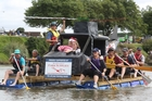 IN THE LEAD: The Farmers Rescue Chopper team (pictured) came first in Saturday's river raft race.PHOTO/BEVAN CONLEY