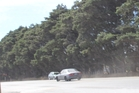 Gale-force winds at Makirikiri yesterday made driving difficult but that didn't stop the driver of this car speeding to try to get away from police.
