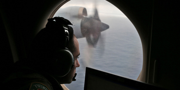 Flight officer Rayan Gharazeddine on board a Royal Australian Air Force AP-3C Orion searches for the missing Malaysia Airlines Flight MH370. AP file photo / Rob Griffith