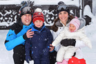 Britain's Prince William and Duchess of Cambridge with their children, Princess Charlotte, right, and Prince George, enjoy a short private break skiing in the French Alps. Photo / AP