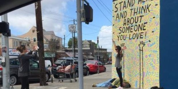 """The mural on Sunset Boulevard in Los Angeles, reads """"Stand here and think about someone you love"""". Photo / Facebook"""