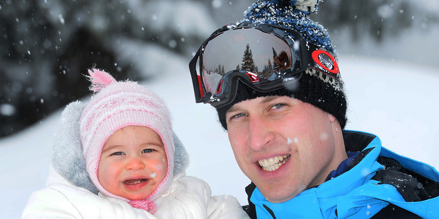 Britain's Prince William poses with Princess Charlotte as they enjoy a short private break skiing in the French Alps. Photo / AP