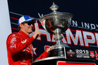 Scott Dixon of New Zealand poses with the IndyCar Championship trophy. Photo / Getty Images
