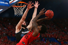 Casey Prather attempts to shoot over Alex Pledger in game three of the Australian NBL grand finals. Photo / Getty