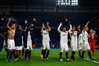 PSG players celebrate following their team's 2-1 victory during the UEFA Champions League round of 16, second leg match against Chelsea. Photo / Getty Images